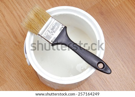 paint cans and paintbrush - stock photo