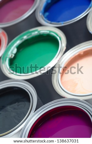 Paint cans on different colors