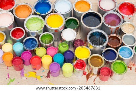 Paint cans on different colors - stock photo