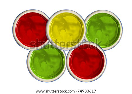 paint cans with yellow, green, red paint (isolated on white, top view) - stock photo