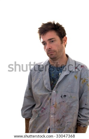 Paint covered home handy man contemplating decorating ideas looking depressed - stock photo
