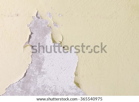 Paint damage on substrate concrete with yellow background.