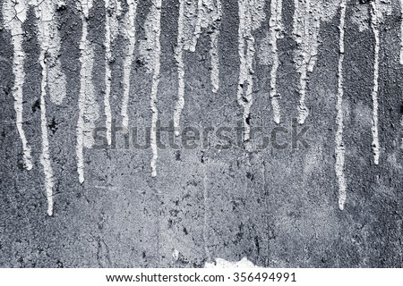 Paint dripping wall background,Weathered concrete wall texture and black paint dripping - stock photo