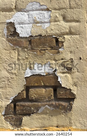 paint falling down from old tile wall - stock photo