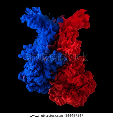 Paint in water. Red and blue blending together on black background - stock photo