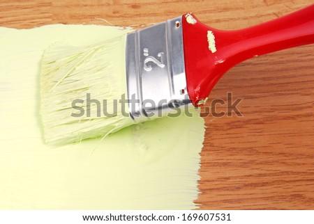 paint on wooden surface - stock photo