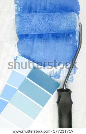 paint roller and color chart choice - stock photo