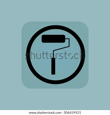 Paint roller in circle, in square, on pale blue background - stock photo