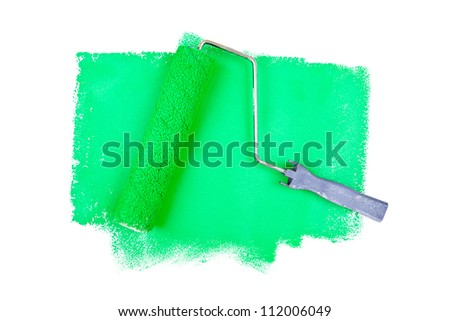 Paint roller on green traces against a white background