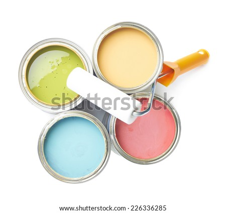 Paint roller over the opened cans of paint, top view above foreshortening, composition isolated over the white background - stock photo