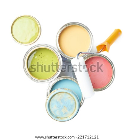 Paint roller over the opened cans of paint, top view above foreshortenings, composition isolated over the white background - stock photo