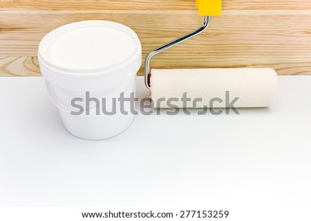 paint roller with paint can ready for use