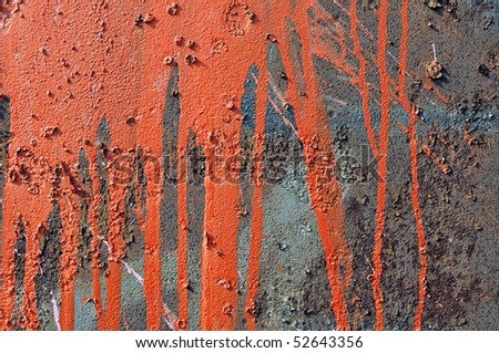 paint runs on rusty metal background - stock photo