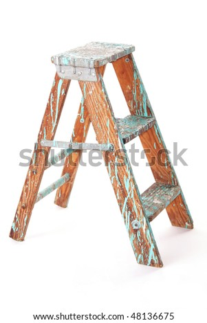 Paint splattered, two-step, wooden step stool, isolated against white background.