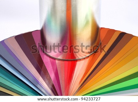Paint tin can container reflects colour sample chart spectrum - stock photo