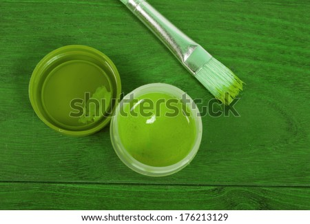 paint with a brush on the wooden table  - stock photo