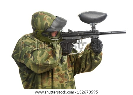 paintball player man in protective camouflage uniform with mask Aiming marker gun over white background