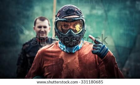Paintball player under rain - stock photo