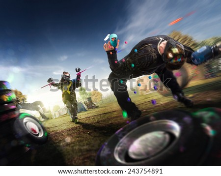 Paintball players are playing the final game - stock photo