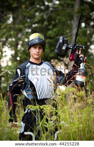 paintball shooter in the field - stock photo