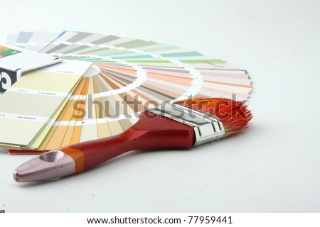 Paintbrush and colorful paint - stock photo