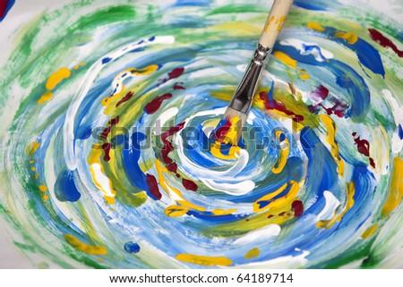 Paintbrush and mixed acrylic paint - stock photo