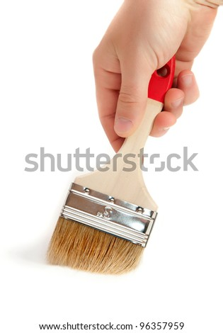 paintbrush in hand on white background