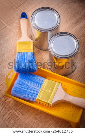 paintbrush on paint tray and cans construction concept  - stock photo