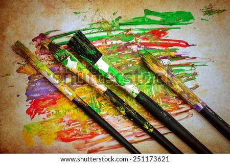 paintbrush on paper - stock photo