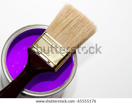Paintbrush on purple paint can - stock photo
