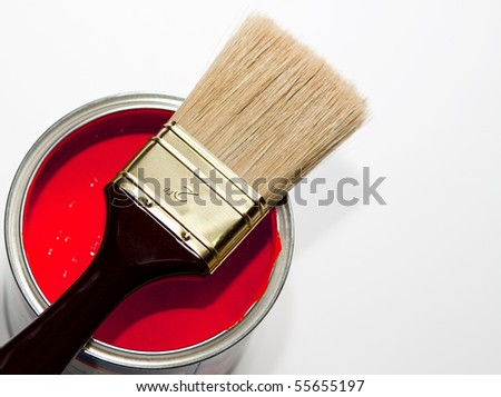 paintbrush on red paint can - stock photo