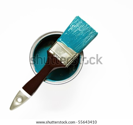 paintbrush on turquoise paint can - stock photo