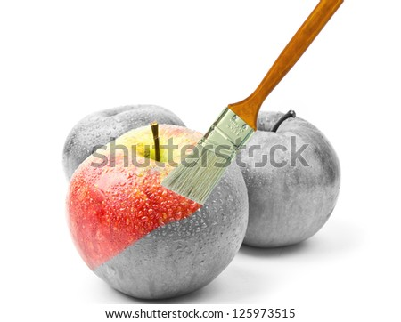 paintbrush painting a fresh red wet apple which is partly black and white and partly colored - stock photo
