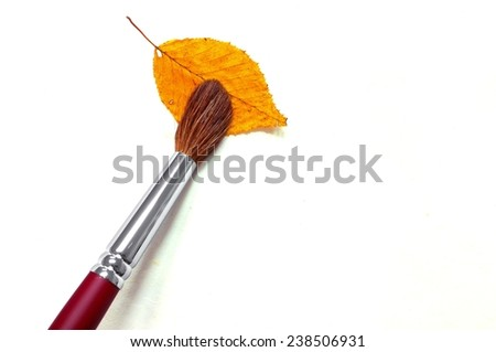 paintbrush with leaf on paper