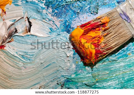 Paintbrush with oil paint on a classical palette - stock photo