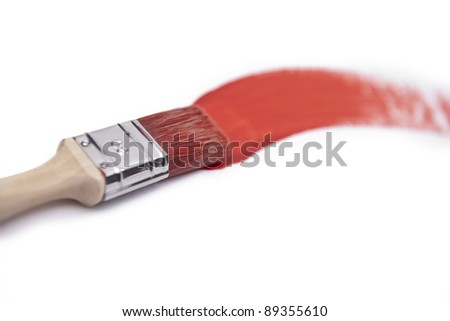paintbrush with red paint - stock photo