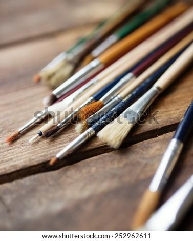 Paintbrushes on a wood background, - stock photo