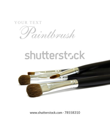 Paintbrushes on white background