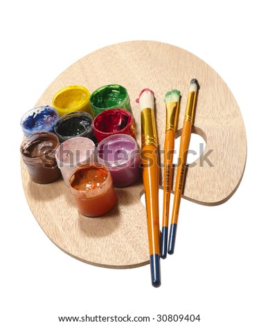 paintbrushes on wooden palette. RGB concept. isolated with clipping path