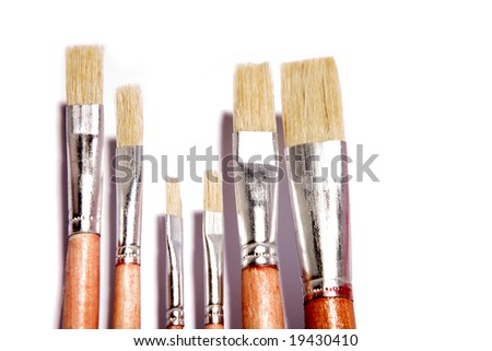Paintbrushes over white
