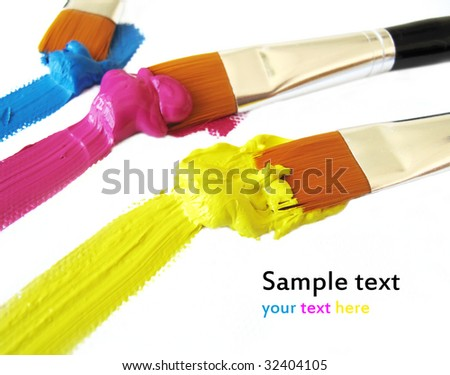 Paintbrushes  with cyan magenta yellow color on white - stock photo