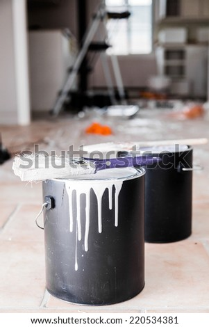 Paintcan and Paint brush dripping with all kind of Painting equipment in background - stock photo