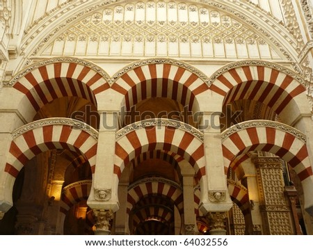 Painted and striped arches in the Mezquita, the old Mosque, in Cordoba, Spain - stock photo