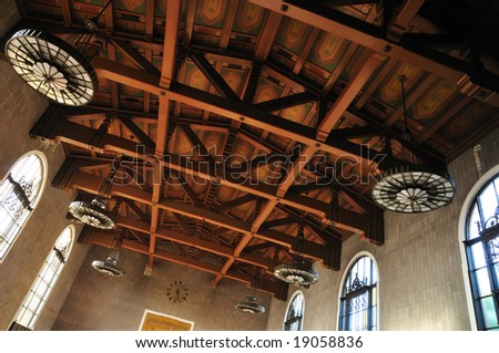 Painted beam ceiling in a Los Angeles train station - stock photo