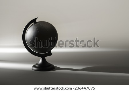 painted black globe earth planet in shadow - stock photo
