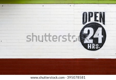 painted brick open 24 hours - stock photo