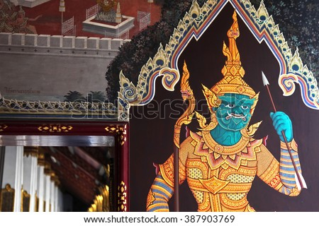 Painted Buddhist religious figure - stock photo