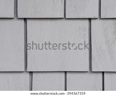 Painted cedar shingles on side wall  - stock photo
