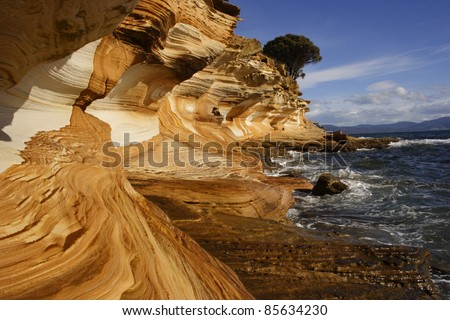 Painted cliff formation on Maria island off the eastern coast of Tasmania Australia - stock photo