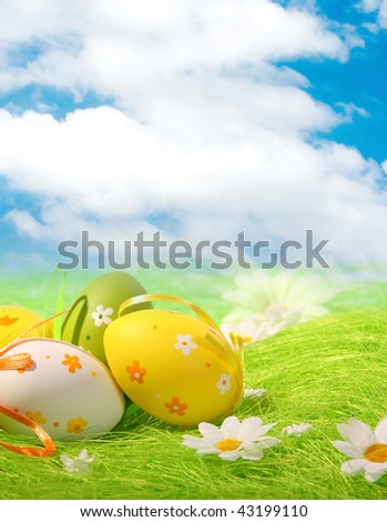 Painted Colorful Easter Eggs on green Grass